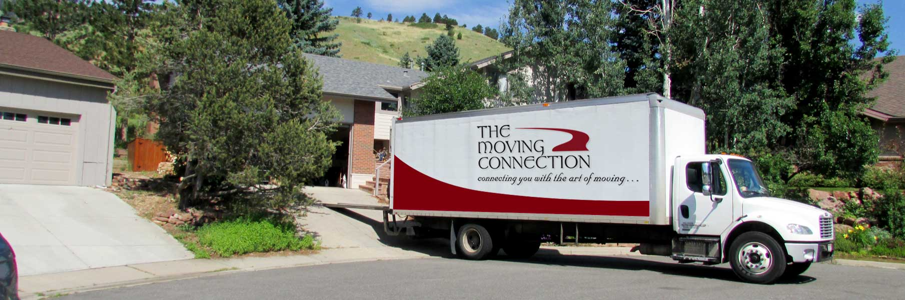 The Moving Connection truck and movers at Boulder job site