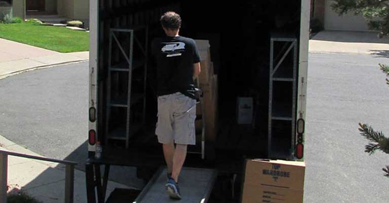 Crew loading boxes onto truck
